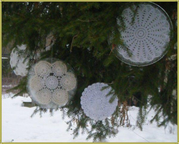 снежинки вязаные между дисков